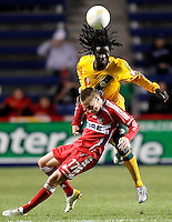 LA Galaxy defender Ugo Ihemelu (15) heads the ball over Chicago Fire forward Chris Rolfe (17).  The Chicago Fire defeated the Los Angeles Galaxy 3-1 in the championship game of the U.S. Open Cup at Toyota Park in Bridgeview, IL on September 27, 2006...