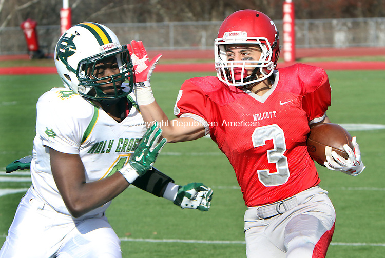 WOLCOTT CT. 26 November 2015-112615SV04-#3 Jacob Ramos of Wolcott High runs for yardage as #4 Tyler Rudolph of Holy Cross High defends during football action in Wolcott Thursday.<br /> Steven Valenti Republican-American