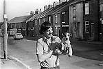 Miner Mick Walstow with pet Jack Russell dog called Suzy with plaster on broken leg. South Kirkby Colliery Yorkshire England Miners Story. 1979.<br />