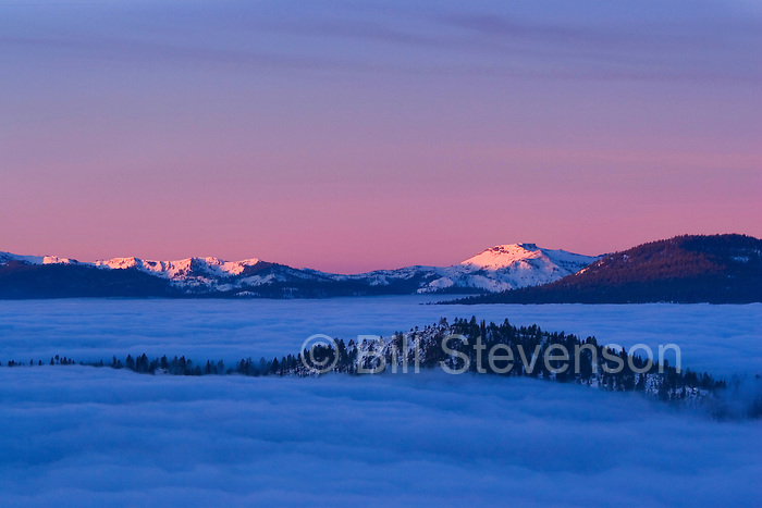 A photo of sunrise and a sea of clouds over Lake Tahoe and in winter in Nevada