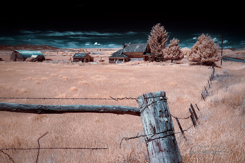 Abandoned Farmstead, Ovid, Idaho (Infrared) ©2018 James D Peterson.  Now empty and looking a bit forlorn, this crumbling home still harbors traces of the lives and spirits of its departed occupants.