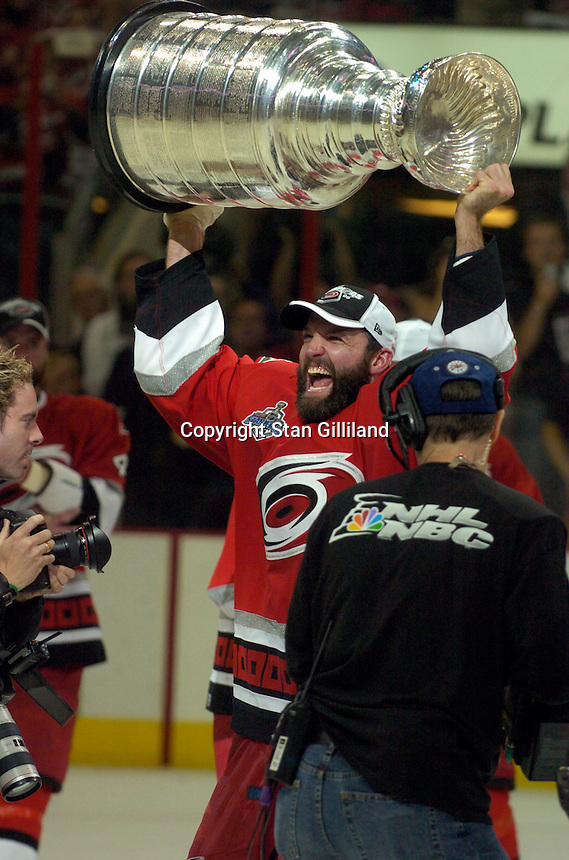 Bret Hedican holds the Stanley Cup after the Carolina Hurricanes beat the Edmonton Oilers 3-1 in game seven to win the series at the RBC Center in Raleigh, NC Monday, June 19, 2006.