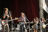 The Zutons - L-R: Russell Pritchard, Dave McCabe, Abi Harding and touring guitarist Paull Molloy - performing live at Hyde Park Calling in Hyde Park London UK - 02 Jul 2006.  Photo credit: George Chin/IconicPix