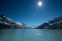 Summer landscape of sun glistening off water with Johns Hopkins Glacier in Johns Hopkins Inlet with Fairweather Mountains in Glacier Bay National Park in Southeast, Alaska   <br /> <br /> (C) Jeff Schultz/SchultzPhoto.com