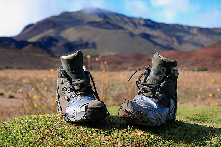 Worn out hiking boots wrapped in duct tape will walk no more in the crater of HALEAKALA NATIONAL PARK on Maui in Hawaii USA