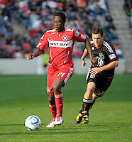 Chicago Fire forward Patrick Nyarko (14) dribbles the ball in front of DC United forward Pablo Hernandez (21).  The Chicago Fire tied DC United 0-0 at Toyota Park in Bridgeview, IL on Oct. 16, 2010.