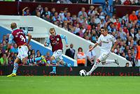 Saturday 15 September 2012<br /> Pictured: Pablo Hernandez of Swansea (R) against Karim El Ahmadi (L) and Barry Bannan (C) of Aston Villa.<br /> Re: Barclay's Premier League, Aston Villa v Swansea City FC at Villa Park, West Midlands, UK.