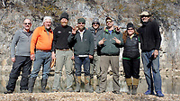 NWA Democrat-Gazette/DAVID GOTTSCHALK Eric McMillan (from left), Bob Kramer, Rich Hall, Dan Held, David Gottschalk, Greg Adams, Amanda Kay Whelchel-Harris and Robert Walsh stand Thursday, February 8, 2018,for a group photograph on the banks of the Meramec River. The eight paddlers from the Fayetteville area spent February 2-10, 2018 floating 46 miles of the spring fed river in Missouri.