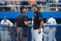 Wake Forest Demon Deacons head coach Tom Walter (16) discusses a call with home plate umpire Perry Costello during the game against the Florida Gators in the completion of Game Two of the Gainesville Super Regional of the 2017 College World Series at Alfred McKethan Stadium at Perry Field on June 12, 2017 in Gainesville, Florida. The Demon Deacons walked off the Gators 8-6 in 11 innings. (Brian Westerholt/Four Seam Images)