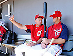 12 March 2011: Washington Nationals' Hitting Coach Rick Eckstein (left) chats with Bryce Harper in the dugout prior to a Spring Training game against the New York Yankees at Space Coast Stadium in Viera, Florida. The Nationals edged out the Yankees 6-5 in Grapefruit League action. Mandatory Credit: Ed Wolfstein Photo