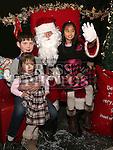 Hannah, James and Roisín visiting Santa at the Laurence Centre.