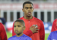 WASHINGTON, D.C. - OCTOBER 11: Reggie Cannon #20 of the United States during the national anthem prior to their Nations League game versus Cuba at Audi Field, on October 11, 2019 in Washington D.C.