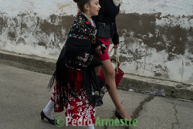 "Women in traditional dress is seen during the Carantoñas festival, in Acehúche near Cáceres, on January 21, 2015. The ""Carantoñas"", monster-animal characters mixing paganism with Christianity, search for Saint Sebastian in the streets of the village of Acehúche, southwestern Estremadure province, dressed in patchwork sheep, cow, rabbit and goatskins under painted masks. Arriving eventually at the village church, a procession takes place with the statue of the patron saint. Until recently, Spain's neighbors, the Berbers of Morocco, preserved a version of the same ritual in their animal-hided winter ""goblin,"" Bou Inania.  © Pedro ARMESTRE"