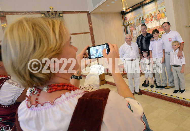 PSHRINE07P<br /> Christina Szumal of Denver, Colorado makes a picture of her family during the 50th annual Polish American family festival and country fair at the National Shrine of Our Lady of Czestochowa Sunday September 6, 2015 in Doylestown, Pennsylvania.  (William Thomas Cain/For The Inquirer)