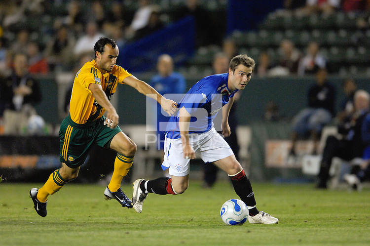 Los Angeles Galaxy's Landon Donovan tries to stop Rangers F.C. Kevin Thomson. The Glasgow Rangers FC beat the LA Galaxy 1-0 in an International friendly match played at the Home Depot Center in Carson, California, Wednesday, May 23, 2007.