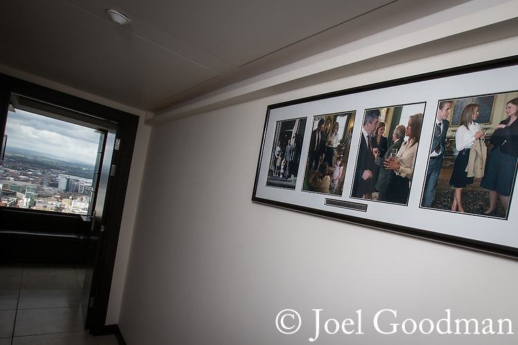 © Joel Goodman - 07973 332324 . 24 June 2013 . Orchid Suite , Beetham Tower , Manchester , UK . Photographs of Phil and Julie Neville meeting Gordon Brown MP at Number Ten Downing Street on a hallway wall . Former triplex apartment home of Phil and Julie Neville , which is up for rent and thought to be the most expensive in Manchester . Photo credit : Joel Goodman