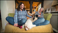 BNPS.co.uk (01202 558833)<br /> Pic: TomWren/BNPS<br /> <br /> Emma Childs (left) and business partner Abby Bolt relax with Barry and the dogs on the sofa.<br /> <br /> It's a dogs life for 'Barry the lamb' - The precious Valais Blacknose lamb is being hand reared by owner Emma Childs after being rejected by his mother.<br /> <br /> Emma took Barry the lamb into her home last month so she could bottle-feed him round the clock after his mum rejected him as a newborn.<br /> <br /> Barry, now four weeks old, is a valuable rare Valais Blacknose, a breed that was only introduced to the UK from the Swiss Alps in 2014.