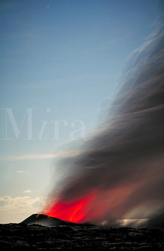 Waha'ula Lava Tube spews lava; steam plume rises as molten lava enters Pacific ocean;  Kilauea Volcano; Volcanoes National Park, Hawaii. Hawaii USA Big Island.