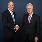 VISA President John Partridge and Former U.S. President Bill Clinton