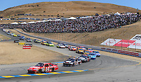 Jun. 21, 2009; Sonoma, CA, USA; NASCAR Sprint Cup Series driver Tony Stewart (14) leads teammate Ryan Newman (39) during the SaveMart 350 at Infineon Raceway. Mandatory Credit: Mark J. Rebilas-