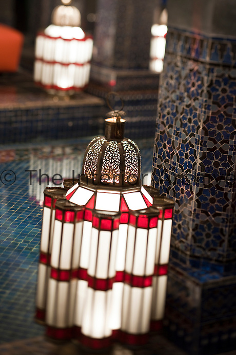 A large glass lantern by the plunge pool of one of the private hammams with intricate mosaic tiles