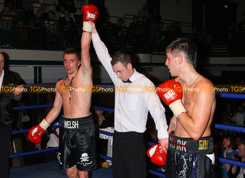 Martin Welsh (black shorts) defeats Ryan Clark (black/white shorts) in a Welterweight boxing contest at York Hall, Bethnal Green, promoted by Miranda Carter / Left Jab - 21/03/10 - MANDATORY CREDIT: Gavin Ellis/TGSPHOTO - Self billing applies where appropriate - Tel: 0845 094 6026