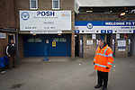 Peterborough United 1 Chesterfield 0, 21/03/2015. Abax Stadium, League One. A steward on duty outside the London Road stand covered terrace at the Abax Stadium, before Peterborough United play Chesterfield in a SkyBet League One fixture. The home team won the match by one goal to nil, watched by a crowd of 6,612. The result allowed Peterborough to leapfrog their opponents into the League One play-off positions with eight games remaining of the season. Photo by Colin McPherson.