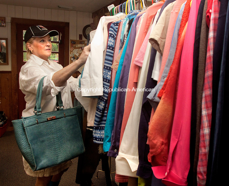 WOODBURY, CT 23 SEPTEMBER 2015 -093015DA03-Lori Davies of Woodbury shops at the Red Barn Thrift Shop in Woodbury on Wednesday. The shop will collect unwearable or wanted items and transport them to be recycled. The EPA and DEEP both estimate that only about 15 percent all discarded textiles, that includes clothing, curtains, blankets and ect. is recycled.<br /> Darlene Douty Republican-American