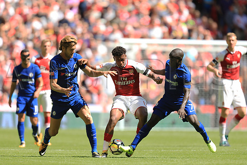 August 6th 2017, Wembley Stadium, London, England; FA Community Shield Final; Arsenal versus Chelsea; Alex Iwobi of Arsenal is challenged by Ngolo Kante and Marcos Alonso of Chelsea