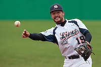 17 October 2010: Romain Martinez-Scott of Savigny smiles to the cemera as he throws the ball to first base during Rouen 10-5 win over Savigny, during game 2 of the French championship finals, in Savigny sur Orge, France.