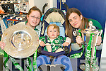 RUBGY FANS: Irish rugby supports Alanna Donegan and Clodagh Donegan Ward from Moyvane and Niamh O'Connell from Listowel holding the Grand Slam and Treble Crown trophies at O2 shop in the Square, Tralee on Sunday.