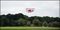 BNPS.co.uk (01202 558833)<br /> Pic: RobHenry/BNPS<br /> <br /> Take-off.<br /> <br /> The feared Fokker Dreidecker of the Red Baron has finally flown over Britian skies - after British based German doctor 'Baron' Peter von Brueggemann spent 9 years building a replica in his garage.<br /> <br /> The German GP based in Norfolk has spent 9 years building a Fokker triplane as a tribute to infamous WW1 Ace Manfred von Ricthofen, who terrorised the skies over the Western front during the first war.<br /> <br /> Dr Peter Brueggemann, 53, fufilled his childhood dream and emulated the notorious German fighter Ace when his hand built Dreidecker finally took off this week.<br /> <br /> Dr Brueggemann has even acquired the title Baron from the independent territory of Sealand so he can take to the skies as Baron Peter von Brueggemann in homage to his idol.<br /> <br /> The GP at the Holt Medical Practice in Norfolk finally reached for the sky at Felthorpe airfield near Norwich this week in front of nervous friends and family after thousands of hours spent crafting the aircraft.<br /> <br /> The father-of-two, who has lived in England with wife Sue for 20 years, has been taking flying lessons since his project began.