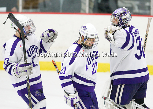 Casey Brugman (Curry - 17), Brett Kaneshiro (Curry - 21), Derek Mohney (Curry - 30) - The Curry College Colonels defeated the Johnson & Wales University Wildcats 5-4 on Curry's senior night on Saturday, February 18, 2012, at Max Ulin Rink in Milton, Massachusetts.