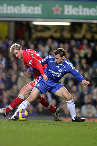 31 January 2007: Chelsea striker Andriy Shevchenko competes with Stephane Henchoz for the ball during the Premiership game between Chelsea and Blackburn Rovers, played at Stamford Bridge. Chelsea won the match 3-0. Photo: Actionplus....070131 football soccer player