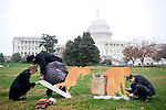 "From left, Katryn Bowe, Ari Singh and Chris Hall, all of CSIS (Center for Strategic & International Studies) set up toilet displays on Nov. 19, 2009, on the West Lawn of the Capitol in preparation for the World Toilet Day event to ""raise awareness of the 2.5 billion people without toilets, through exhibits, speeches and poems."""