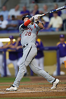Auburn Tigers first baseman Garrett Cooper #28 follows through on his swing against the LSU Tigers in the NCAA baseball game on March 22nd, 2013 at Alex Box Stadium in Baton Rouge, Louisiana. LSU defeated Auburn 9-4. (Andrew Woolley/Four Seam Images).