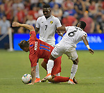 Jose Rodriguez (7) of Panama and Kevin Galvan (6) of Panama double-team Jordan Morris (11) of the United States during their Gold Cup match on June 26, 2019 at Children's Mercy Park in Kansas City, KS.<br /> Tim VIZER/AFP