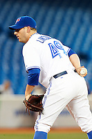 Toronto Blue Jays pitcher Brad Lincoln #49 during an American League game against the Seattle Mariners at the Rogers Centre on September 13, 2012 in Toronto, Ontario.  Toronto defeated Seattle 8-3.  (Mike Janes/Four Seam Images)