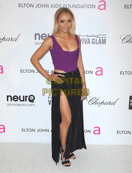 Kat Graham.The 21st Annual Elton John AIDS Foundation Academy Awards Viewing Party held at The City of West Hollywood Park in West Hollywood, California, USA..February 24th, 2013.oscars full length hand on hip Katerina black skirt slit split purple sleeveless top cleavage .CAP/DVS.©DVS/Capital Pictures.
