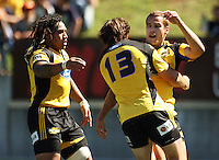 Ma'a Nonu (left) and Conrad Smith congratulate Hurricanes fullback Tamati Ellison on his try..Super 14 rugby union match, Hurricanes v Cheetahs at Yarrows Stadium, New Plymouth, New Zealand. Saturday 7 March 2009. Photo: Dave Lintott / lintottphoto.co.nz