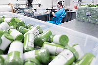 A worker fills oral syringes with cannabis concentrate known as Rick Simpson Oil (RSO) at the production and packaging facility for Garden Remedies, a medical cannabis producer, in Fitchburg, Massachusetts, USA, on Fri., Feb. 22, 2019.