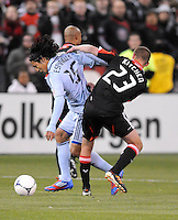Sporting Kansas City midfielder Roger Espinoza (15) goes against D.C. United midfielder Perry Kitchen (23) Sporting Kansas City defeated D.C. United  1-0 at RFK Stadium, Saturday March 10, 2012.
