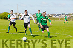 Action from Fenit's  Darren Lynch and Islands Stan Devane at the  Greyhound Bar KO Cup Quarter Final Replay Fenit Samphires  V  Castleisland Afc at Fenit on Sunday