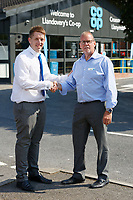 Manager Gethin Adams (L) with colleague