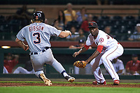 Scottsdale Scorpions relief pitcher Samil De Los Santos (61), of the Los Angeles Angels organization, prepares to apply a tag to Cam Gibson (3) during an Arizona Fall League game against the Mesa Solar Sox on October 23, 2017 at Scottsdale Stadium in Scottsdale, Arizona. The Solar Sox defeated the Scorpions 5-2. (Zachary Lucy/Four Seam Images)