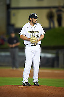 UCF Knights relief pitcher Trent Thompson (42) gets ready to deliver a pitch during a game against the Siena Saints on February 17, 2017 at UCF Baseball Complex in Orlando, Florida.  UCF defeated Siena 17-6.  (Mike Janes/Four Seam Images)