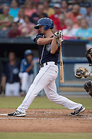 Asheville Tourists designated hitter Ashley Graeter #6 swings at a pitch during a game against the Savannah Sand Gnats at McCormick Field July 17, 2014 in Asheville, North Carolina. The Tourists defeated the Sand Gnats 8-7. (Tony Farlow/Four Seam Images)