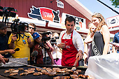 2020 Democratic Presidential Hopeful Peter Buttigieg flips pork chops as he tours the Iowa State Fair in Des Moines, Iowa on August 13, 2019. Credit: Alex Edelman / CNP
