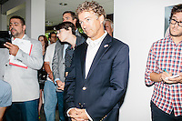 Kentucky senator and Republican presidential candidate Rand Paul waits at the side of the room to begin a town hall campaign event at Kilton Library in West Lebanon, New Hampshire.