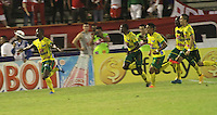 NEIVA -HUILA -COLOMBIA, 22-NOVIEMBRE-2014.Carlos Diaz del Atletico Huila  celebra su gol contra  el Independeinte Santa Fe  durante partido por los cuadrangulares semifinales 3 fecha  de la Liga Postobón 2014-II , jugado en el estadio Guillermo Plazas Alcid de la ciudad de Neiva./ Carlos Diaz   of Atletico Huila  celebrates his goal agaisnt Independiente Santa Fe  during the semifinal  match runs 3th date Postobón II League 2014 played at Guillermo Plazas Alcid stadium in Neiva city.Photo / VizzorImage / Felipe Caicedo  / Staff